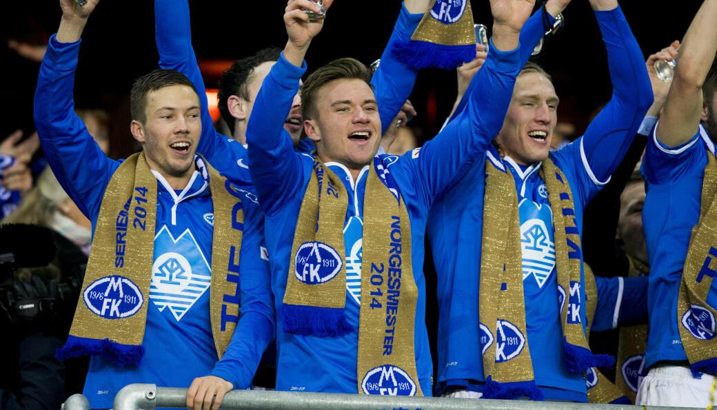 NM-fotball, cupfinale menn 2014: Martin Linnes (f.v.), Fredrik Gulbrandsen og Per-Egil Flo jubler etter ha vunnet cupfinalen i fotball mellom Molde og Odd på Ullevaal stadion. Molde vant finalen 2-0.